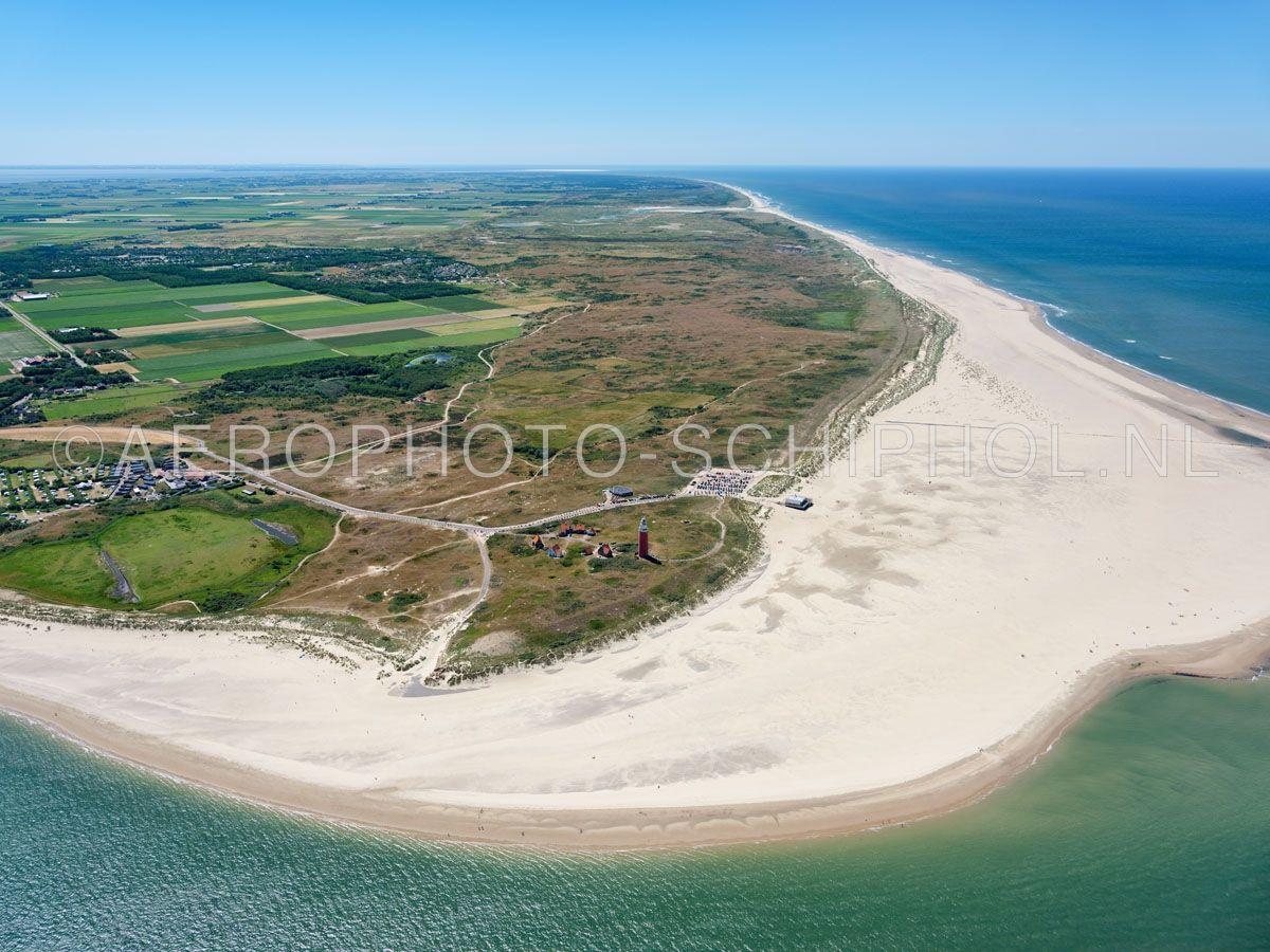luchtfoto    Texel. Eierland  met links polder Eijerland . Eierland was een eiland  dat was gescheiden met Texel door het Anegat, waar nu de Slufter ligt (links). Rond 1550  ontstond een gebied van zandbanken en kwelders dat alleen bij extreem hoog water onderliep. In opn. 01/07/2018